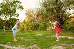 Kids playing in a suburban neighborhood. Royalty Free Stock Photography