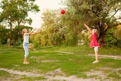 Kids playing in a suburban neighborhood. Stock Photos