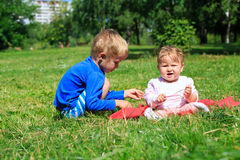 Kids playing in summer park Stock Image