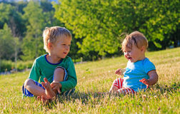 Kids playing in summer park Stock Photography