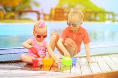 Kids playing in swimming pool at the beach. Little boy and girl playing in swimming pool at the beach Royalty Free Stock Photo