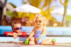 Kids playing in swimming pool at the beach. Little boy and girl playing in swimming pool at the beach Stock Photos