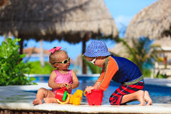 Kids playing in swimming pool at beach Stock Photography