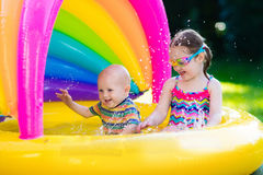Kids playing in swimming pool Royalty Free Stock Photos