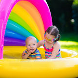 Kids playing in swimming pool Stock Image