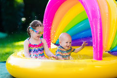 Kids playing in swimming pool Royalty Free Stock Photo