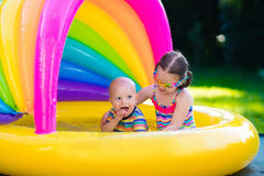 Kids playing in swimming pool Stock Photo