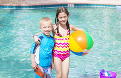 Kids Playing at the swimming Pool Royalty Free Stock Photo