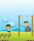 Kids playing swing Royalty Free Stock Photo