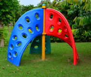 Kids playing swing. Colorful swing for kids in a park Royalty Free Stock Photo