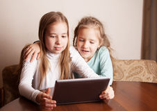 Kids playing on tablet Stock Photos