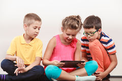 Kids playing on tablet. Royalty Free Stock Image