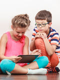 Kids playing on tablet. Stock Photo