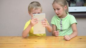 Kids playing with tablet stock video
