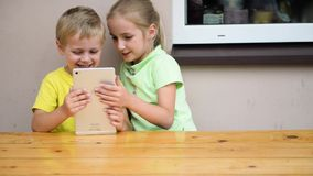 Kids playing with tablet stock video footage