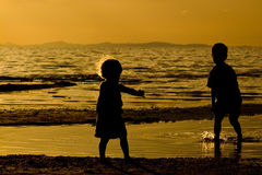 Kids playing on te Beach. Kids playing on the beach - silhouette shot Royalty Free Stock Photos