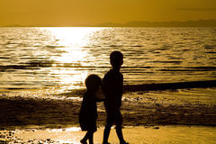 Kids playing on te Beach. Kids playing on the beach - silhouette shot Royalty Free Stock Photography
