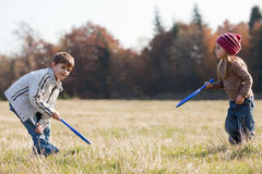 Kids playing tennis outside Royalty Free Stock Image