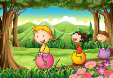 Kids playing with their bouncing balloons at the forest. Illustration of the kids playing with their bouncing balloons at the forest Royalty Free Stock Image
