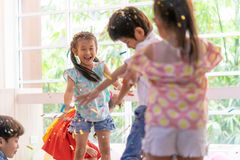 Kids playing and throwing paper in kid party stock photos