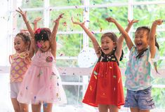 Kids playing and throwing paper in kid party. Kids are playing and throwing paper in kid party stock image