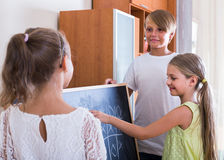 Kids playing at Tic-tac-toe in living room Stock Photos