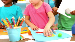 Kids playing together with arts and crafts items stock footage
