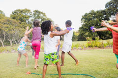 Kids playing together during a sunny day Royalty Free Stock Photo