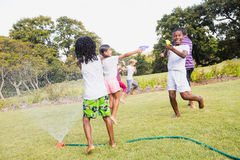 Kids playing together during a sunny day Royalty Free Stock Image