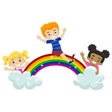Kids playing at the top of the rainbow Royalty Free Stock Images