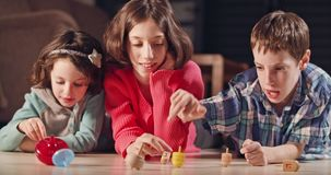 Kids playing with dreidels during Hanukka at home. Kids playing with toy dreidels during Hanukka at home stock video