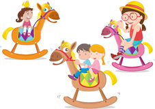 Kids playing toy-horse Stock Photos
