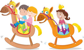 Kids playing toy-horse Royalty Free Stock Image