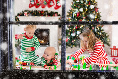 Kids playing with toy railroad on Christmas morning Stock Photography