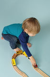 Kids playing with toy trains Stock Photography