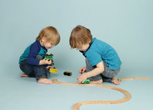 Kids playing with toy trains Stock Images