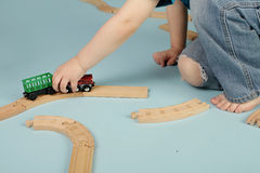 Kids playing with toy trains Royalty Free Stock Photos
