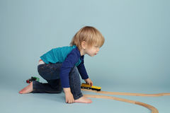 Kids playing with toy trains Stock Image