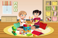 Kids playing toys Royalty Free Stock Images