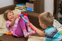 Kids are playing with toys stock images