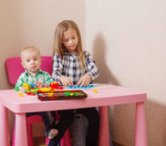 Kids playing with  toys Stock Photography