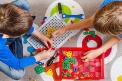 Kids playing with toys tool kit.Top view Royalty Free Stock Photography