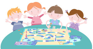 Kids Playing Traditional Board Game Royalty Free Stock Image