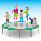 Kids playing trampoline Royalty Free Stock Image