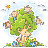 Kids playing in the tree Stock Photography