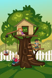 Kids playing in a tree house Royalty Free Stock Image