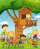 Kids playing in the treehouse Royalty Free Stock Image