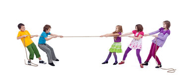 Kids playing tug of war. Girls versus boys, isolated stock photography