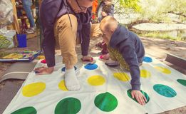 Twister. Kids playing twister game outdoors royalty free stock images