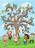 Kids playing under cake tree Stock Photo